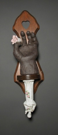 St. Francis, by Lee Pufffer. Ceramic and found object.