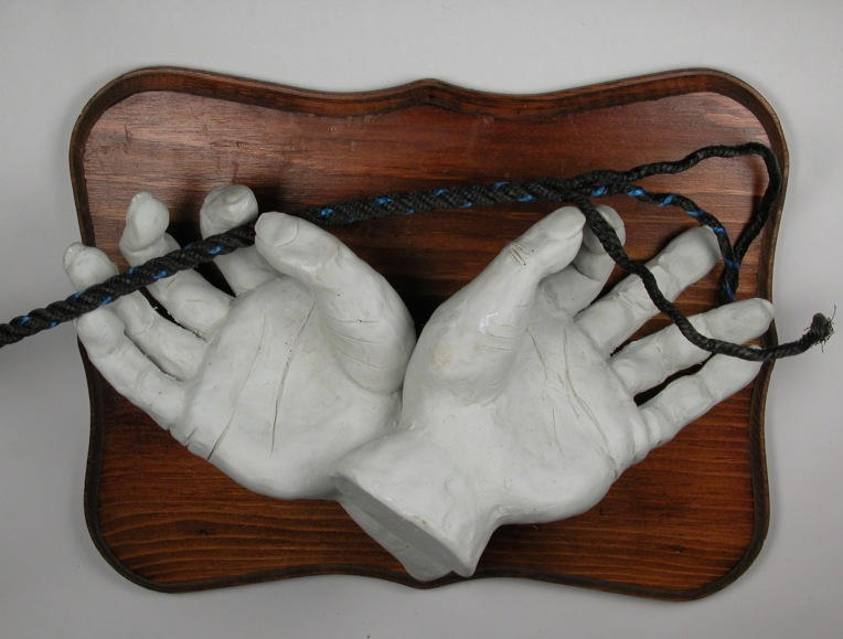 from the Cat's Cradle series, by Lee Puffer. Unglazed high fired porcelain, wood, rope.