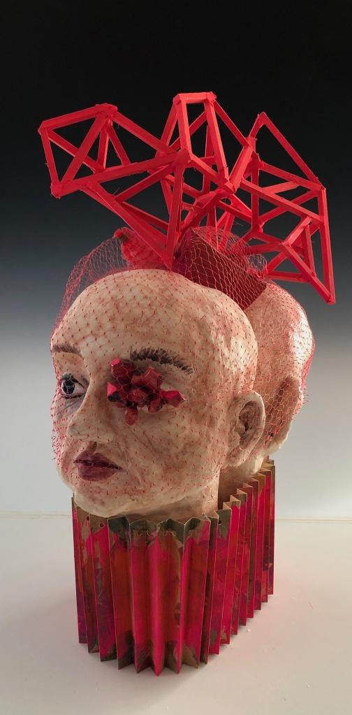 sculpture of 2 heads