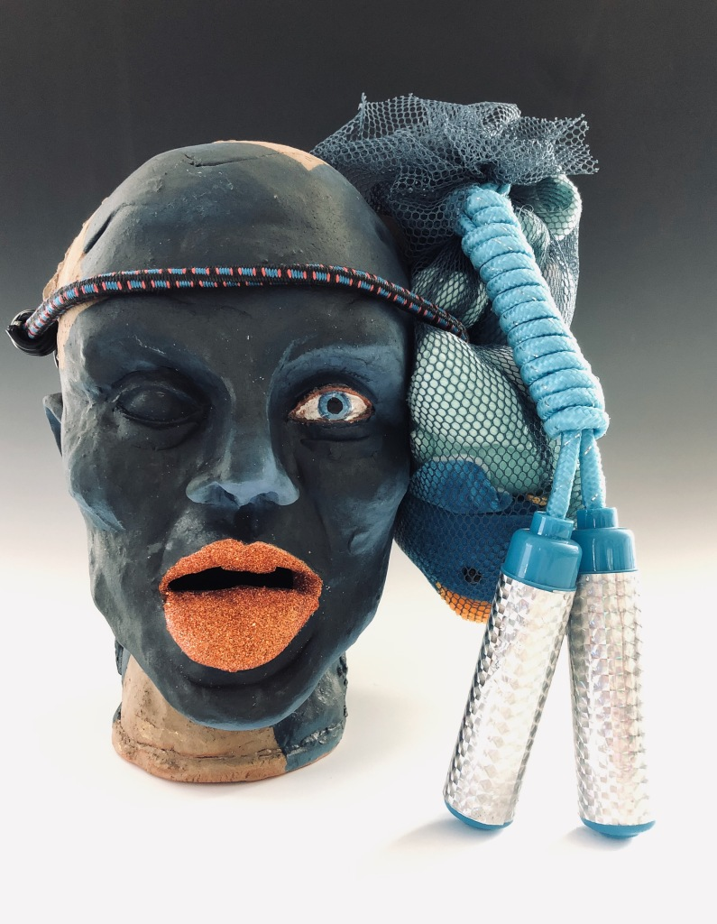 Ceramics Head with bungee cord and toys.